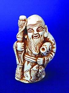 Нэцкэ Эбису - бог счастья и удачи.