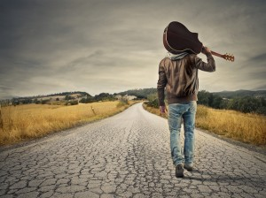 bigstock-young-musician-on-the-road-to-52068637