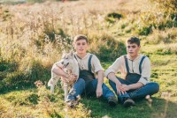 depositphotos_106036892-stock-photo-two-twin-brothers-with-husky